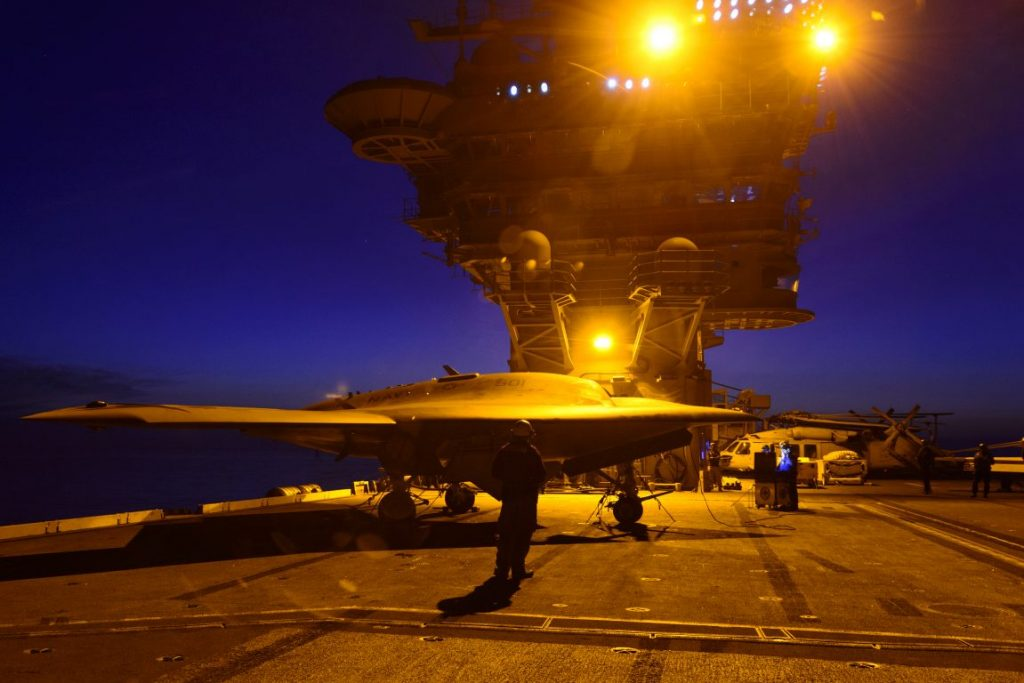 140821-N-CE233 ATLANTIC OCEAN (August 21, 2014) – The Navy's unmanned X-47B conducts night flight operations aboard the aircraft carrier USS Theodore Roosevelt (CVN 71). The aircraft completed a series of tests demonstrating its ability to operate saf
